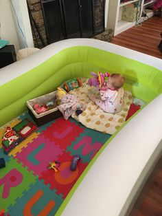 Baby pool play pen! This was the perfect idea when our baby started crawling and now it's perfect for her to practice walking around the edges! Baby proof, crash proof! Make sure you buy one that has thick walls, ours is a initex that's 22 inches tall (off amazon)! Should contain her for a while!