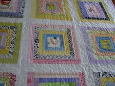 Pretty quilting pattern - esp the swirls in the sashing