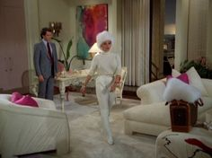 Greg Natale's secrets to choosing and arranging cushions appear to be inspired by Alexis Carrington!