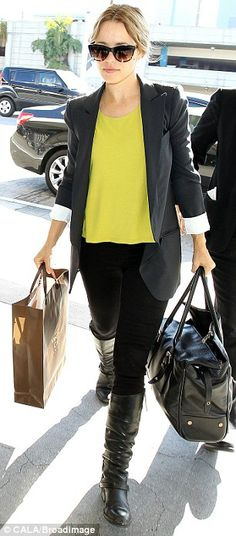 Have bags, will travel: McAdams enters LAX on Friday with her luggage