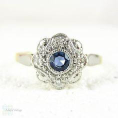 Sapphire & Diamond Daisy Engagement Ring, Blue Sapphire in Floral Shape Diamond Halo with Milgrain Beading. Circa 1930s, 18ct and Platinum.