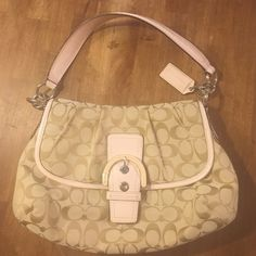 Beautiful coach signature bag Beautiful coach signature bag in tan monogram and pale pink patent leather! This bag is just a beauty! It's like new and has a long enough strap for over shoulder wear! It also has pockets for organization, cell pocket, keys, large back pocket full length for mail, bills, etc, has a pocket with a zipper inside and a full length back pocket outside! Coach Bags Shoulder Bags