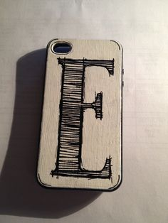 DIY personalized phone case. Acrylic paint, calligraphy pens, and clear nail polish.