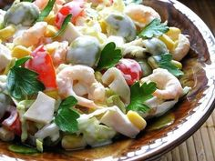 Salad with shrimp, squid, olives and corn