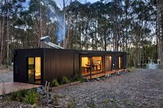 A Perfectly Proportioned Prefab Cabin Secluded in a Forest Clearing Secluded, prefabricated bliss. Musk Prefab Cabin by Modscape (via Lunchbox Architect) The Green Life Small Modular Homes, Modern Prefab Homes, Prefab Tiny Houses, Small Prefab Cabins, Prefabricated Houses, Container Home Designs, Container Shop, Shipping Container Cabin, Shiping Container Homes