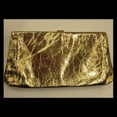 J.Crew gold leather clutch J.Crew crackled gold clutch with snap closure. It has been worn a once but is still like new—and is perfect for the holiday season. J. Crew Bags Clutches & Wristlets