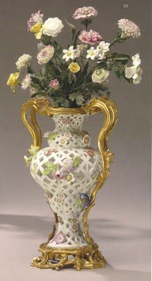 ormolu-mounted Meissen porcelain potpourri pierced baluster-form vases, circa 1750, have German and French flower decorations, 18th/19th century.