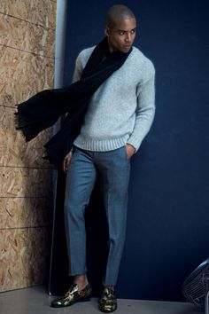 Malik wears sweater AMI by Alexandre Mattiussi, pants J.Crew, scarf Club Monaco and shoes Jimmy Choo.