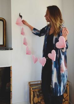 Want an EASY way to decorate for valentine's day? Whether you're spending it with a partner or having a fun galentine's, this adorable 30 minute DIY Valentine's Paper Garland is perfect for your inner romantic! Valentines Bricolage, Valentine Day Crafts, Valentine Decorations, Paper Decorations, Be My Valentine, Paper Garlands, Valentines Day Chocolates, Heart Garland, Heart Banner