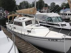 Red Wing 18' Pocket Cruiser - different...sailboat converted to motor launch. Pricey for 18-foot ...