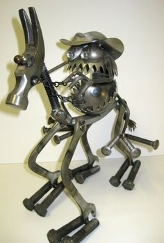 GNOME BE GONES :: Specialty Pieces :: GBG Horse Rider - Sugar Post is the home of Fred Conlon's distinctive and engaging metal art