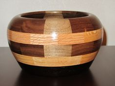 "Segmented wood bowl -- Woods used: Oak, Walnut, & Black Maple -- Pieces of wood: 49 -- 4"" tall 7.5"" dia. #13"