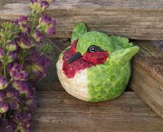 """5"""" Nature's Story Portly Hummingbird Outdoor Patio and Garden Statue by Evergreen. $24.99. Hummingbird StatueItem #84805Add a touch of wildlife to your garden decor with this portly feathered hand-painted hummingbirdDimensions: 5.1""""L x 5""""W x 4""""HMaterial(s): synthetic. Save 17%!"""