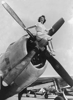 """one of the many women who worked manufacturing the war machines that propelled allied forces to victory in world war  ii was pauline mauck. she was a real life """"rosie the riveter"""" who worked in a republic aviation p-47 plant in evansville, iowa during wwii. she posed on the propeller of one of the planes coming out of the plant and it became an iconic image during the war."""