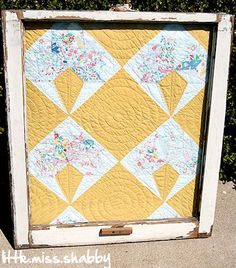 old quilt blocks in vintage window panes   vintage quilt in an old window - Little Miss Shabby--Great idea now I ...