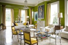 At the other end of the double parlor, a Paramount sofa by Edward Ferrell + Lewis Mittman is covered in Kerry Joyce's Diamante.  Curtains in Schumacher's Mandarin Silk Stripe with Samuel & Sons trim.    - HouseBeautiful.com