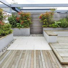 Roof Terrace Design penthouse apartment King's Cross development, expanse of decking storage benches and planters