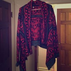 Funky high-low knit cardigan wrap sweater Super soft knit. I always got compliments on this sweater every time I wore it. Unfortunately I haven't worn it on almost a year and it needs to see the outside of my closet. So comfy and in very good used condition. No snags rips or defects. Size small medium but could easily fit a large as I am a size medium large :) WINDSOR Sweaters