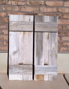 2 Reclaimed Barnwood Shutters 13 x 36, via Etsy.