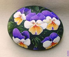 Beautiful pansies on a round stone. I saw the flowers on the photo by winkysan1941. It was taken in Japan. Very beautiful and unusual colors!