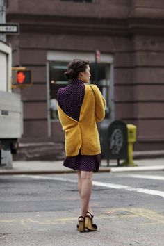 I love her both for her choice of colours and for putting the cardigan on backwards. They both work, and whoulda thunk!