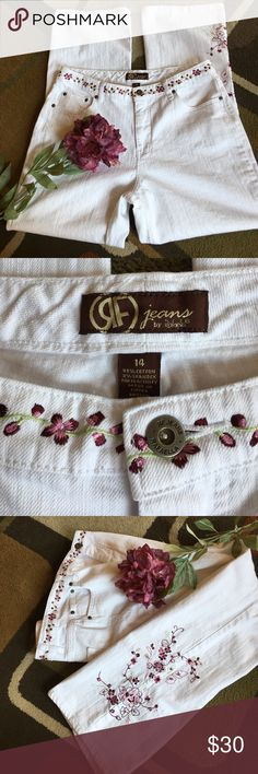 """Rafaella jeans  Beautifully embroidered white jeans embroidered all around waist line and on lower left leg material is 98% cotton 2% spandexlying flat waist measures 17""""  rise is 11""""  inseam is 31"""" Rafaella Jeans"""