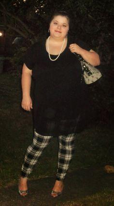 Plus size outfit. Black tunic, plaid leggings, silver heels.