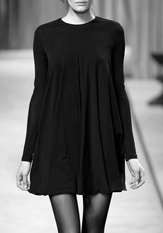 "Aaaaahhh my favorite kind of ""Little Black Dress""... Something about a loose belled bottomed dress that makes me feel comfortable and at my sexiest. Without it, I'd be uncomfortable with the rest of the skanks... ; ) no point intended..."