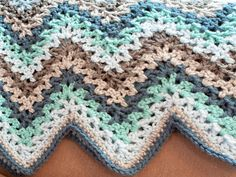 Get ready to fall in love with the Crochet V Stitch Ripple Afghan. In chic coordinating colors of blues and browns, this lacy ripple pattern is a contemporary twist on a classic pattern.