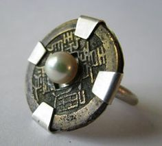 Suzanne Rogge Designs.  Antique brass Chinese coin, Akoya pearl, sterling silver  ||  (Source no longer available)