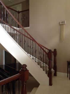 For the Schad home here in Houston, we did a full stair renovation. The railing was replaced with our 6210 curved Oak railing, with model 41...