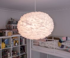 The Eos lampshade is light, fluffy and fun. A perfect addition to the children's bedroom.