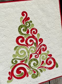 "This is a close up of the wall hanging designed by: Frivolous Necessity (Crystal Stanworth) The pattern title is: ""Swirled Christmas Tree Applique Wall Hanging (scrap friendly) ~ Crystal is a blog writer & fabulous etsy seller with several adorable PDF downloadable quilt patterns for purchase! Must check out her Etsy store!"