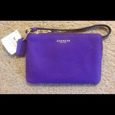 "NWT Coach purple/iris wristlet NWT Coach purple/iris leather wristlet.  Measures approx 6 1/2"" in length & 4"" in height Coach Bags"