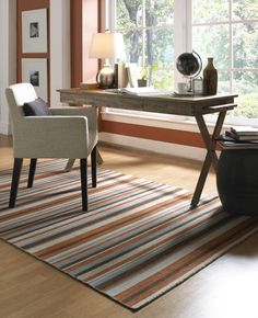 Orange can be calming too, like this pretty wall and soothing striped rug from Surya - CLV-1006