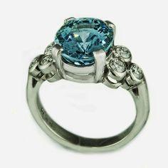 Aquamarine-fleur-de-lis engagement ring by rmrayner, via Flickr