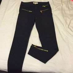 "Michael Kors navy zip pant Michael Kors stretchy material ""riding pant"". They have some lined stitching print on the knees and zips on the front, back and ankles. MICHAEL Michael Kors Pants Skinny"