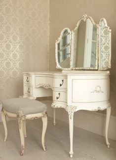 White antique vanity and stool, love the triple mirror.