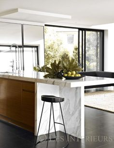 A Calcutta marble kitchen island separates the living and dining areas in the open plan space Stylish Kitchen, New Kitchen, Kitchen Pantry, Kitchen Ideas, Calcutta Marble Kitchen, Calacatta Marble, Marble Wood, Kitchen Interior, Kitchen Design