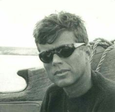 JFK on board of Carodina. By Michael Butler