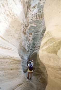 hiking the slots between the rock formations at Tent Rocks Park - outside Santa Fe, New Mexico