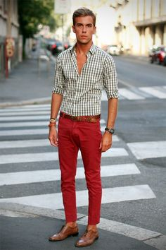 Shop this look for $174:  http://lookastic.com/men/looks/red-jeans-and-walnut-brogues-and-brown-belt-and-white-longsleeve-shirt/578  — Red Jeans  — Walnut Leather Brogues  — Brown Leather Belt  — White Gingham Longsleeve Shirt