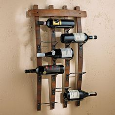 Barrel Stave Wall Rack Authentic barrel staves reclaimed and fitted with recycled iron to cradle up to 9 of your favorite bottles. Rustic appeal.