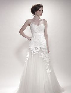 It's discontinued, but I love the delicate flowers and illusion neckline! by Olivia Coture