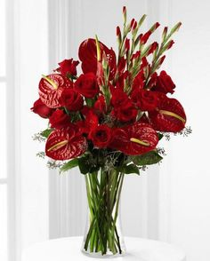 We Fondly Remember Tropical Flower Bouquet of assorted red roses, anthurium and gladiola in vase Large