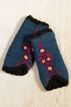 Inspired by a vintage Scandanavian ornamental design, our embroidered wool wristwarmers add a little magic to your outdoor wardrobe.