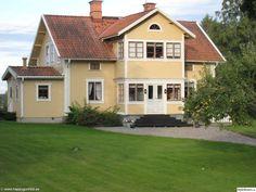 gult hus,trähus,lantligt,romantiskt,landet,husfasad