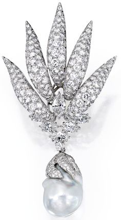 Platinum and Diamond Brooch With a Cultured Pearl and Diamond Drop, By Verdura                 The brooch set with numerous round diamonds weighing 13.50 carats, further set with five marquise-shaped diamonds weighing 2.75 carats and one marquise-shaped diamond weighing 1.50 carats, gross weight approximately 21 dwts, unsigned, circa 1992; suspending a detachable cultured pearl drop of later addition, the cultured pearl measuring approximately 25.1 mm, capped by numerous single-cut diamonds…