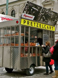 He'd love to eat some of those stuff in the streets of NYC!   pretzel cart new york city