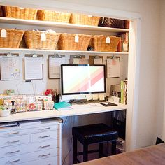 Fantastic closet converted into office with white floating desk, white painted wood toolbox used .